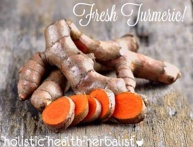 fresh turmeric has a bright orange color and looks like ginger